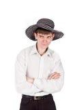 Uomo d'affari in un cappello su una priorità bassa dell'isolato Fotografia Stock Libera da Diritti