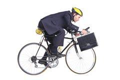 Uomo d'affari in un vestito con una cartella Fotografie Stock