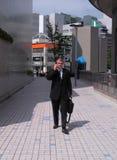 Uomo d'affari in una città Immagine Stock