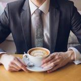 Uomo d'affari in una riunione immagini stock