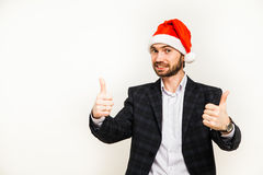 Uomo d'affari in vestito con il cappello della Santa sulla testa Isolato sopra fondo bianco Fotografia Stock