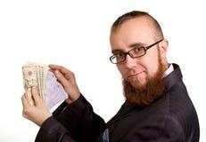 Uomo d'affari in vetri che tengono i dollari Fotografia Stock Libera da Diritti