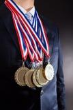Uomo d'affari Wearing Gold Medals Immagini Stock
