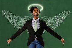 Uomo d'affari With Wings ed alone fotografie stock libere da diritti