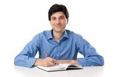 Uomo d'affari Working On Paperwork immagini stock