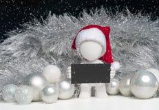uomo 3D con il cappello di Santa che tiene un segno - scena di natale Fotografie Stock