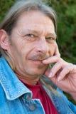 Uomo dai capelli lunghi Fotografia Stock Libera da Diritti