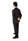 Uomo dalla parte posteriore - esaminare di affari qualcosa Fotografie Stock Libere da Diritti