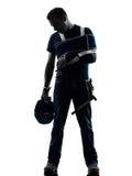 Uomo danneggiato del lavoratore manuale con la siluetta di disperazione del gancio di lesione Fotografia Stock