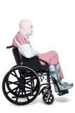 Uomo danneggiato in una vista laterale della sedia a rotelle Fotografia Stock