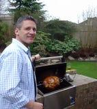 Uomo del barbecue Fotografia Stock Libera da Diritti