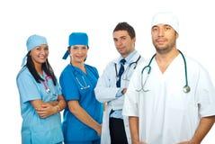 Uomo del chirurgo e la sua squadra Immagine Stock