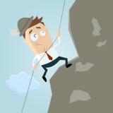 Uomo del fumetto che scala una montagna Fotografie Stock Libere da Diritti