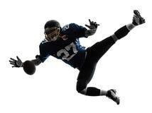 Uomo del giocatore di football americano che prende ricevendo siluetta fotografie stock