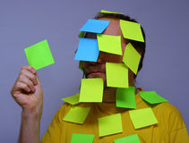 Uomo del post-it Fotografie Stock