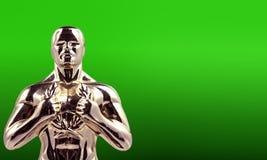 Uomo del trofeo su verde Immagini Stock Libere da Diritti