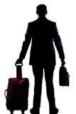Uomo del viaggiatore di affari della siluetta con la valigia Fotografia Stock