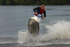 Uomo della foto di azione sul jet ski Fotografia Stock Libera da Diritti