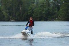 Uomo della foto di azione sul jet ski Immagine Stock Libera da Diritti