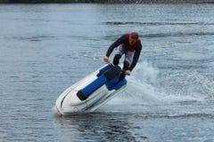 Uomo della foto di azione sul seadoo Jet Ski Tricks Fotografie Stock Libere da Diritti