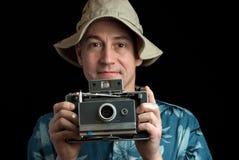 Uomo della macchina fotografica di Insant Fotografia Stock