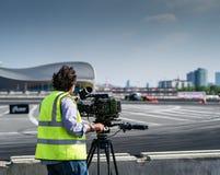 Uomo della macchina fotografica sul GP britannico rotondo della deriva 1-London Immagini Stock Libere da Diritti