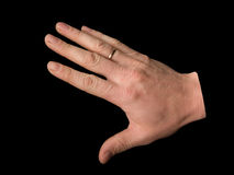 Uomo della mano su una priorità bassa nera Fotografie Stock Libere da Diritti