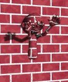Uomo della parete Immagini Stock