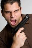 Uomo della pistola Fotografia Stock