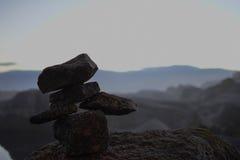 Uomo della roccia sui gusci Fotografia Stock Libera da Diritti