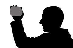 Uomo della siluetta con digicam Fotografia Stock Libera da Diritti