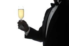 Uomo della siluetta con il vetro di Champagne Immagine Stock