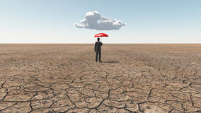 Uomo in deserto con la singola nuvola dell'ombrello Fotografie Stock Libere da Diritti