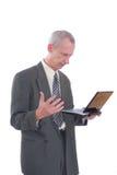 Uomo di affari arrabbiato e computer portatile Fotografie Stock