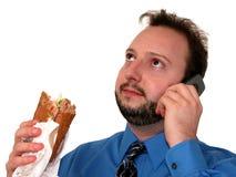 Uomo di affari in azzurro (che mangia pranzo) Fotografia Stock Libera da Diritti
