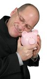 Uomo di affari che abbraccia la Banca Piggy Fotografie Stock Libere da Diritti