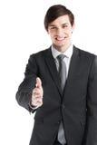 Uomo di affari che allunga mano per stringere Immagine Stock
