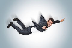 Uomo di affari che cade dal cielo blu Immagine Stock