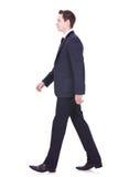Uomo di affari che cammina in avanti Fotografia Stock Libera da Diritti