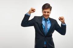 Uomo di affari che celebra successo contro il fondo bianco Fotografia Stock