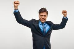 Uomo di affari che celebra successo contro il fondo bianco Immagini Stock Libere da Diritti