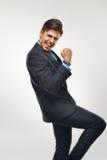 Uomo di affari che celebra successo contro il fondo bianco Fotografia Stock Libera da Diritti