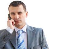 Uomo di affari che comunica sul telefono Immagine Stock Libera da Diritti