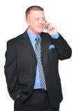 Uomo di affari che comunica sul telefono delle cellule Immagine Stock Libera da Diritti