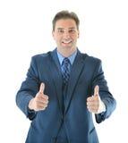 Uomo di affari che dà due grandi pollici su Immagini Stock
