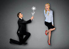 Uomo di affari che dà fiore Fotografia Stock
