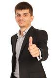 Uomo di affari che dà i pollici Immagini Stock Libere da Diritti