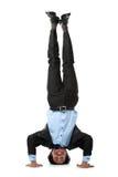 Uomo di affari che fa handstand fotografie stock