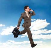 Uomo di affari che funziona con una cartella Fotografia Stock Libera da Diritti