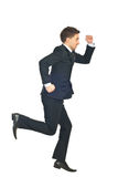 Uomo di affari che funziona via Fotografia Stock